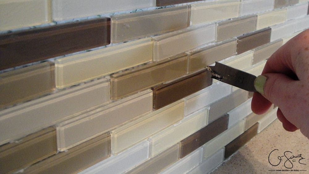 How to lay & prep tiles for a finished kitchen backsplash. These easy to follow DIY instructions will help you better plan the layout for your backsplash!