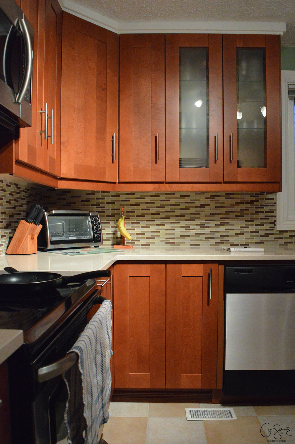 The before and after photo reveal of our DIY kitchen renovation. Check out all the great features we added to make this space unique. I can't believe what it used to look like!