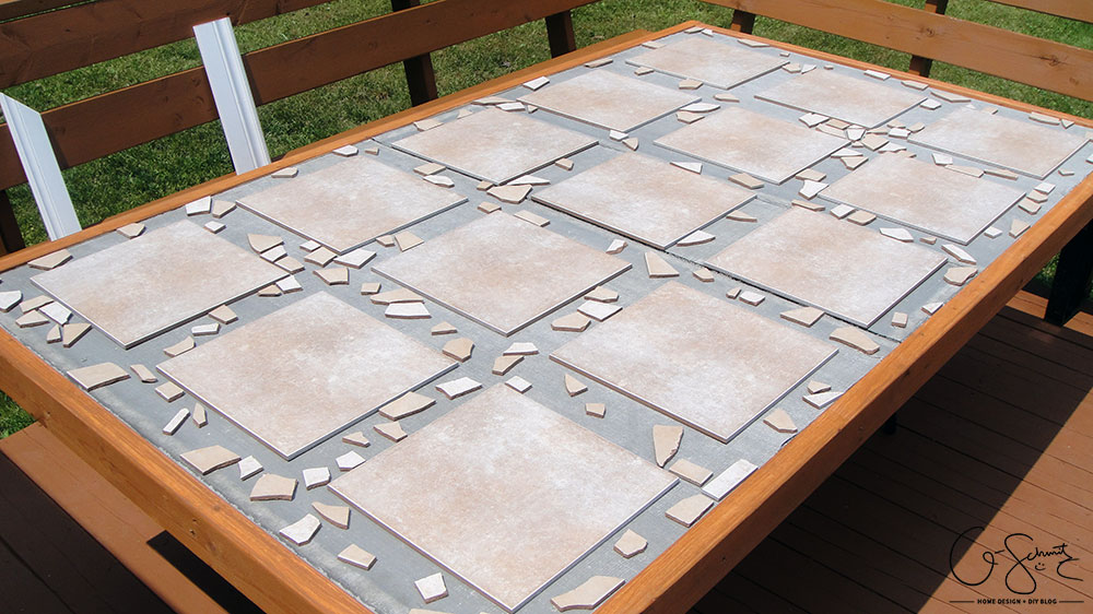 Did your glass patio tabletop break and you're looking to make a new top? Here's a super-duper custom patio table that I made using lots of leftover materials. It's an easy DIY project that can be almost completely customized to anything you want!
