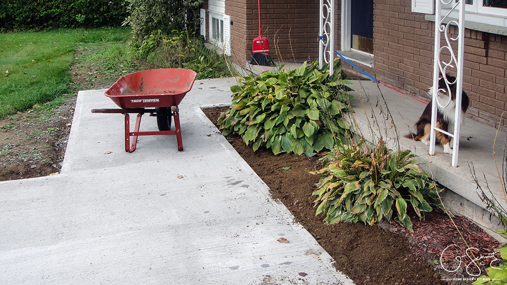 Now that the DIY concrete walkway is in, we just have to do a tiny bit more landscaping and beautification before I can complete this project walkway. Check out the great before and after photos to see all the work we did this summer!