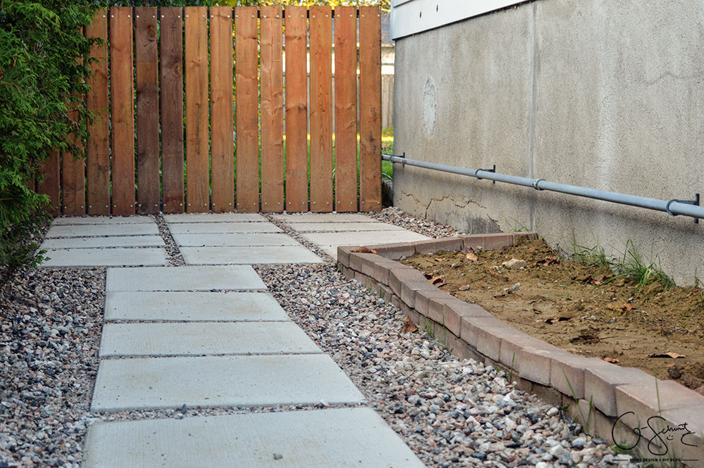 Can you believe this area was just grass and a chain link fence before? Here is the story of how we finished our side yard landscaping :)