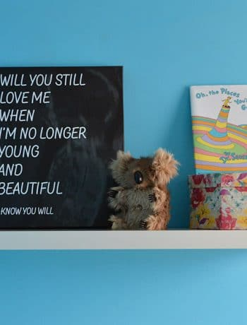 I designed this custom graphic canvas using the image from my baby's ultrasound and some song lyrics. It is the perfect addition to our minimalist nursery.