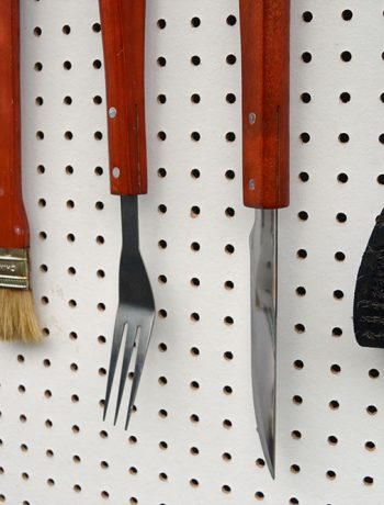 We recently installed a super easy DIY BBQ Pegboard which is great for holding all our barbecue related tools! Let me show you what I mean…
