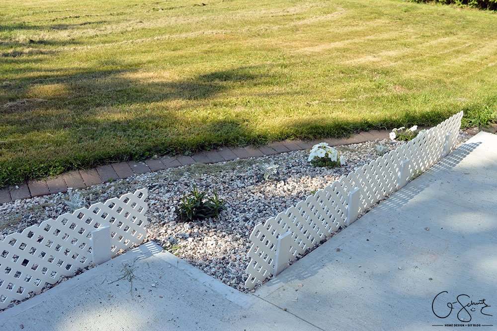 Check out these cute and easy trellis mini-fences that I wanted to install to add height and definition to the flowerbed along our front walkway.