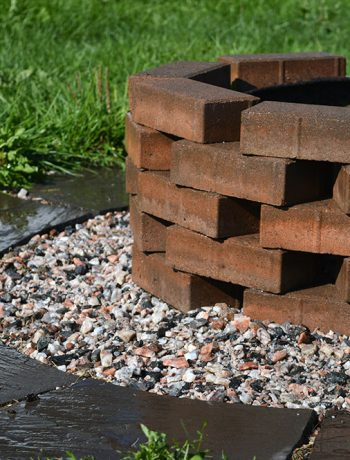 This quick and simple project uses patio pavers and finishing stones to update a not-so-pretty firepit into a pretty and easy DIY firepit!
