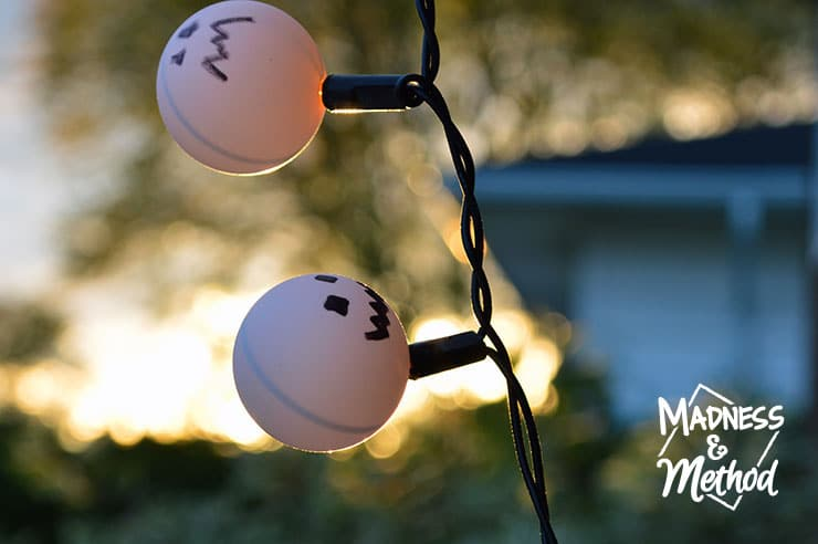 Were you too lazy to take down your Christmas lights last year? Might as well incorporate them into your Halloween décor as pumpkin ping pong lights!