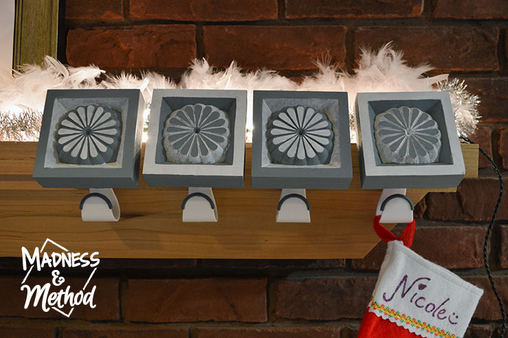 These DIY stocking holders not only look great, but they actually work! Whether you're getting light and fluffy cotton balls for Christmas, or some lumps of coal; your stockings won't come crashing down.