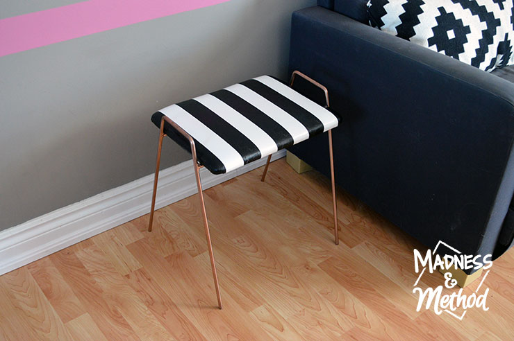 I LOVE how this striped stool makeover fits in perfectly with the black and white décor I have in the upstairs living room. I had originally purchased the stool for another DIY, but I'm happy I changed my mind - let me show you what I mean.