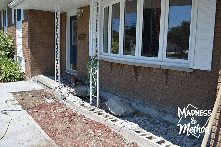 Concrete front porch being torn up