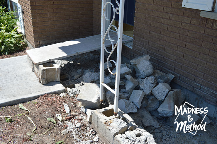 New ramp to door with torn concrete front porch