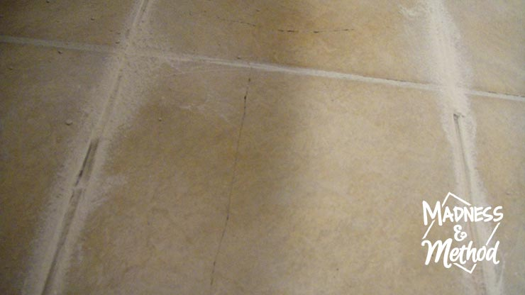 replace a cracked tile by removing grout