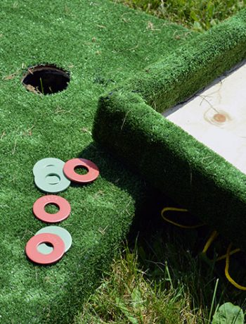 Washer toss game closeup of washers and board