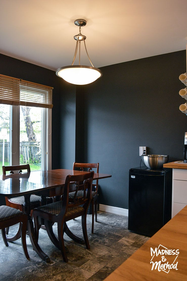 white kitchen and black dining room
