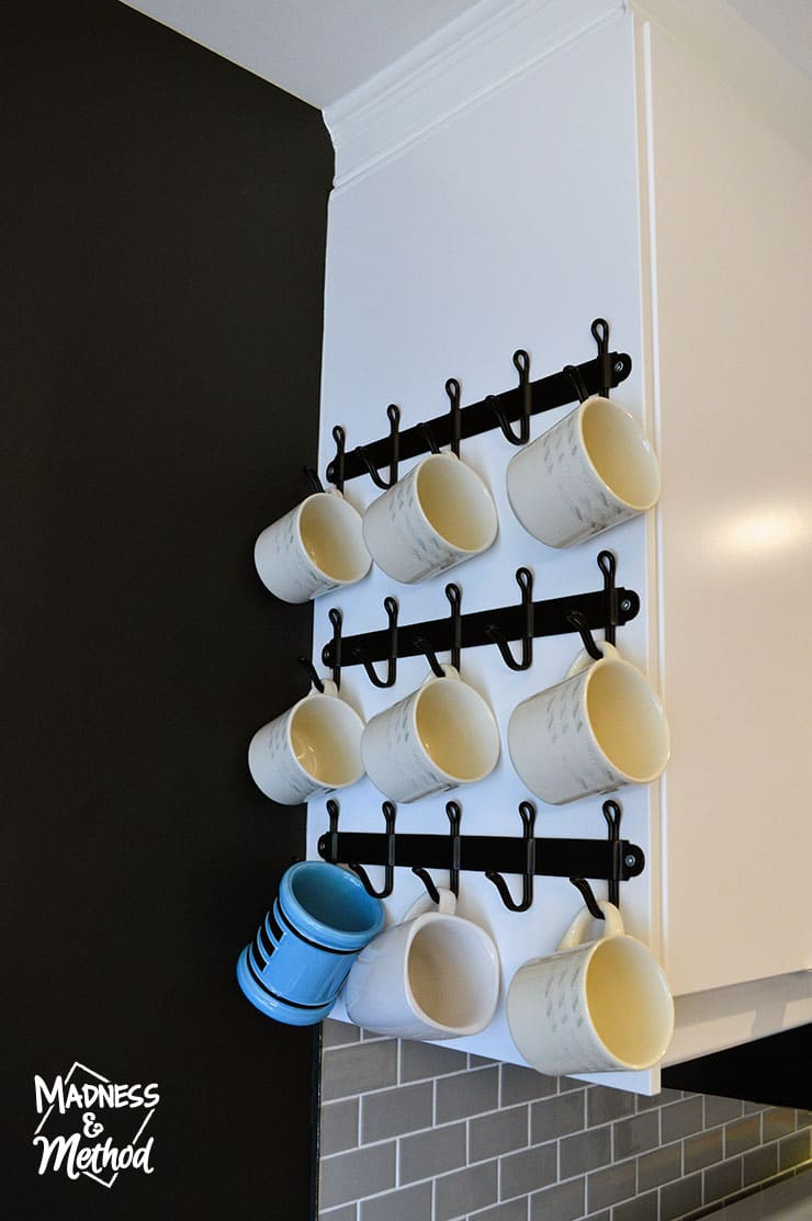 hanging mugs on side of cabinet