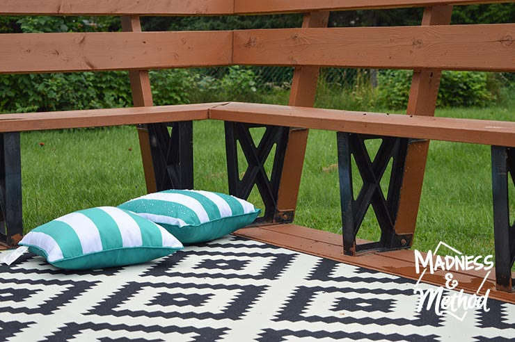 month of august outdoor image with rug and pillows