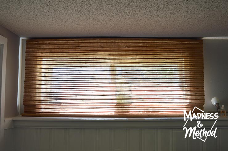 short windows in basement with bamboo blinds