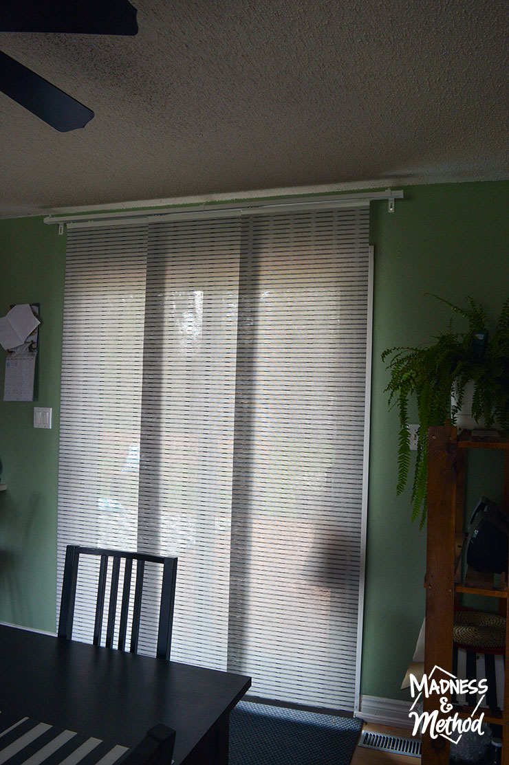 panel curtains from ikea in dining room