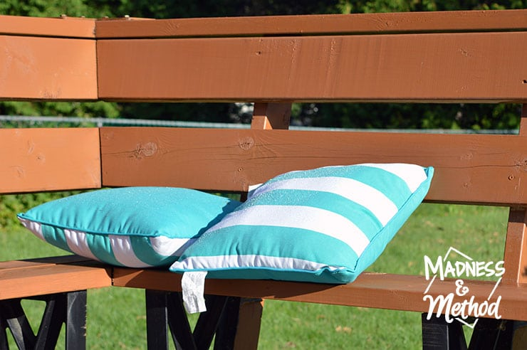 month of september outdoor shot of pillows on deck bench