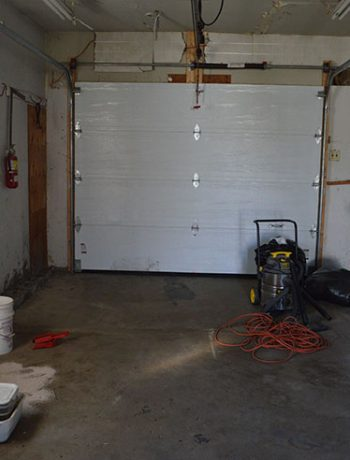 empty garage looking towards door