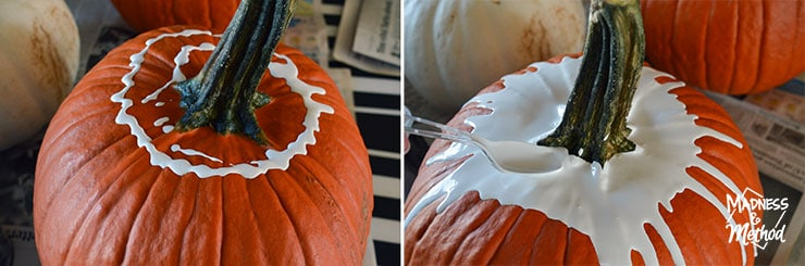 spreading paint on pumpkins for paint-drip technique