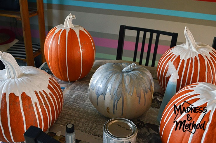 paint-drip pumpkins drying