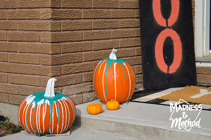 paint-drip pumpkins outside
