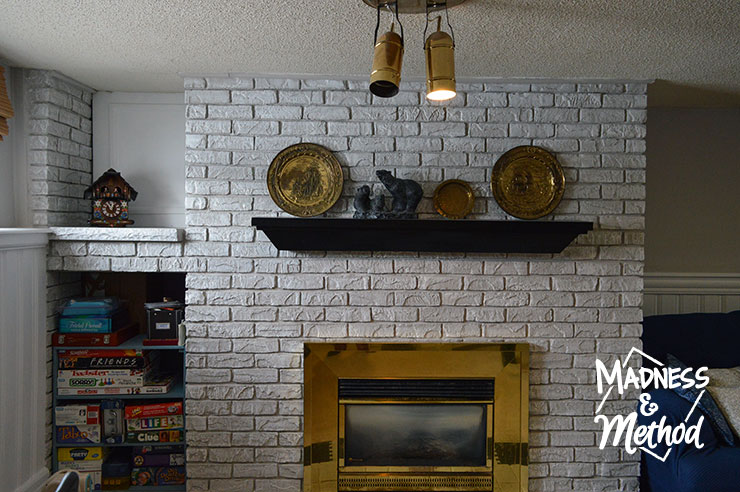 painted gray and white bricks with black mantel