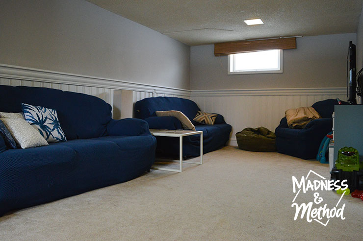 navy blue couches in basement family room