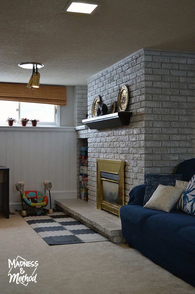 view of fireplace in basement family room