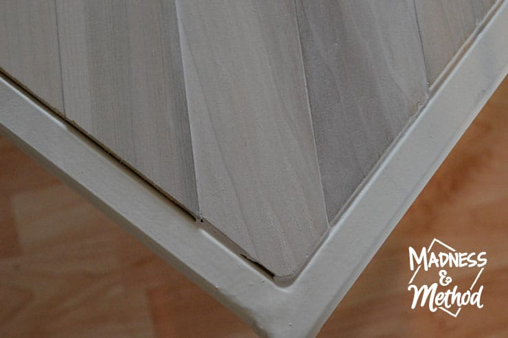 caulking edges of metal and wood coffee table