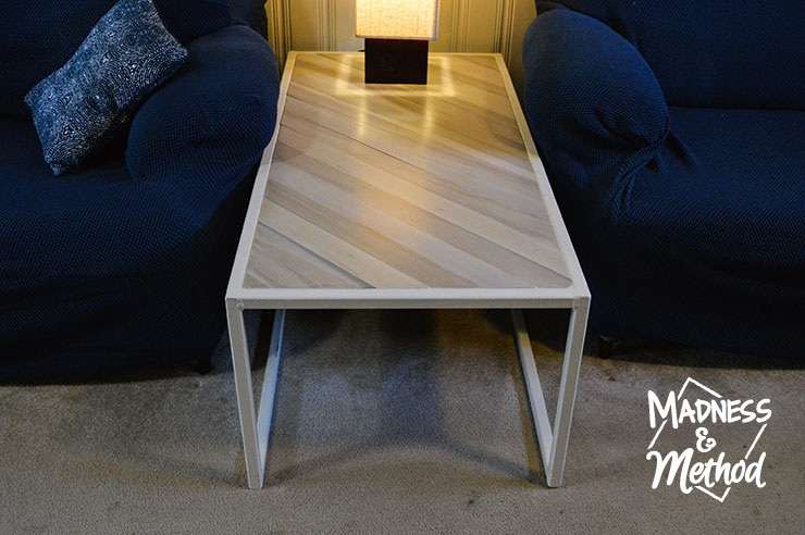 metal and wood coffee table with light