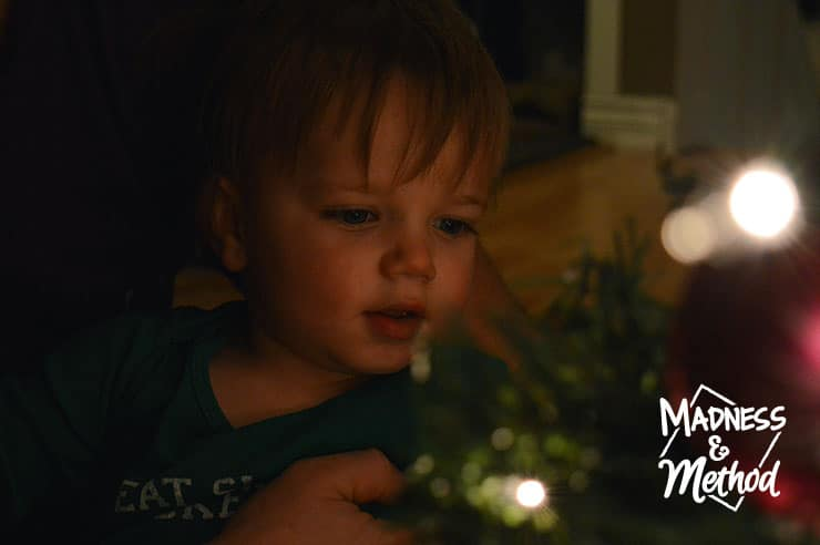 baby looking at christmas tree