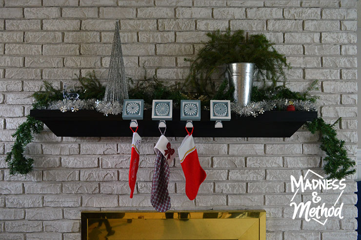 simple silver and green holiday mantel full view