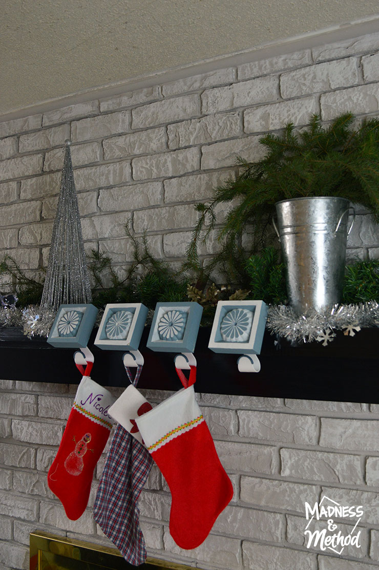 custom stocking hangers on simple mantel