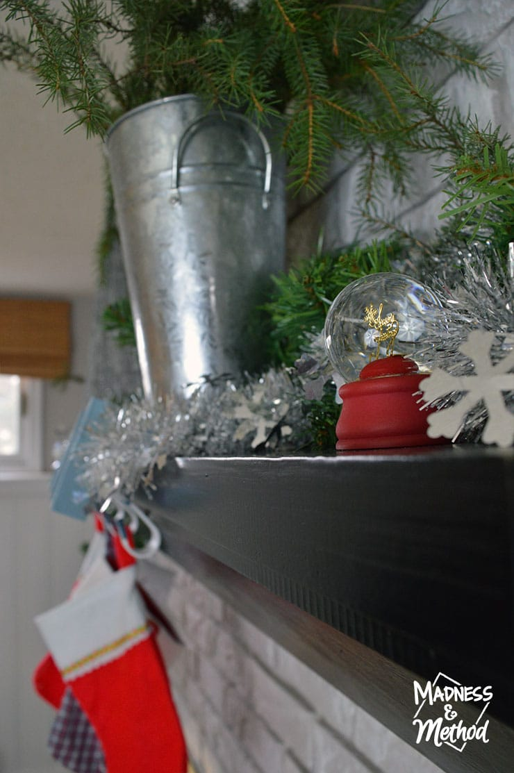 black mantel with holiday decor