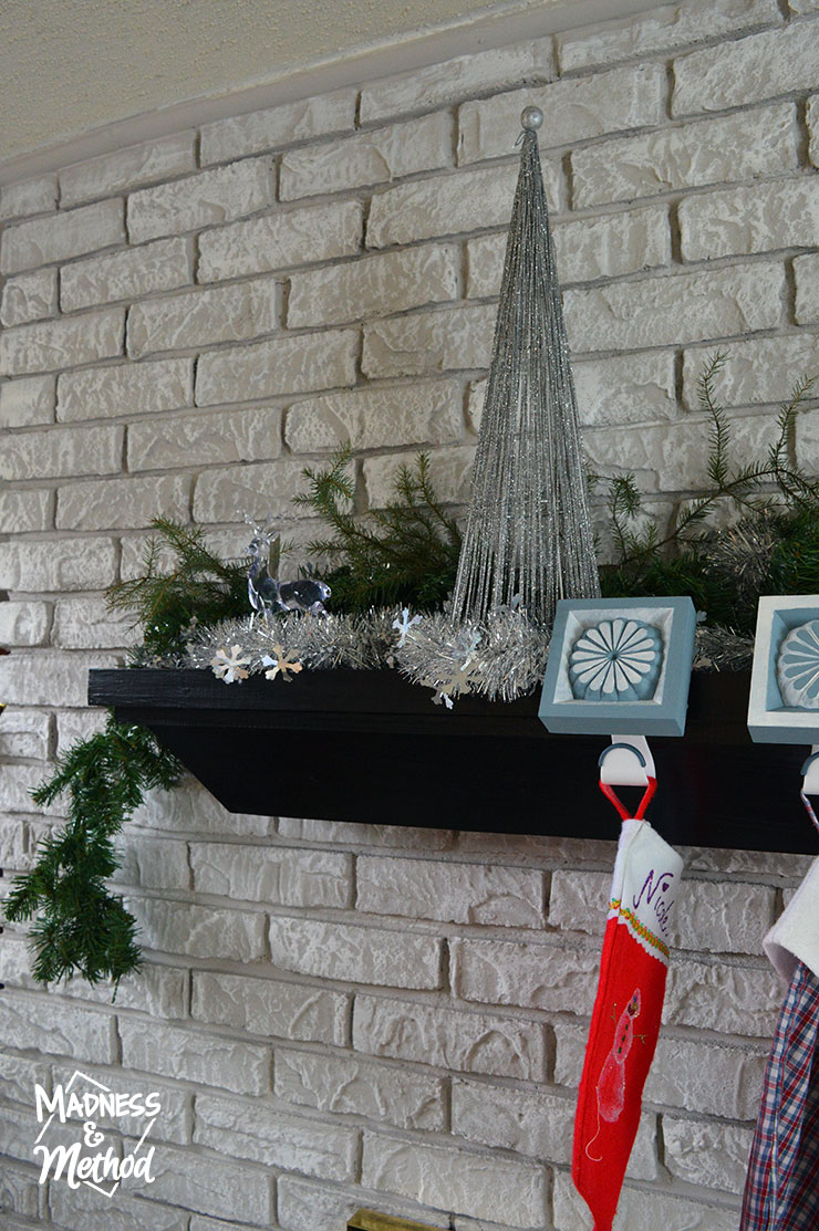 silver and green holiday mantel