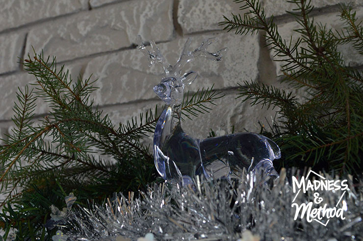 clear reindeer on holiday mantel