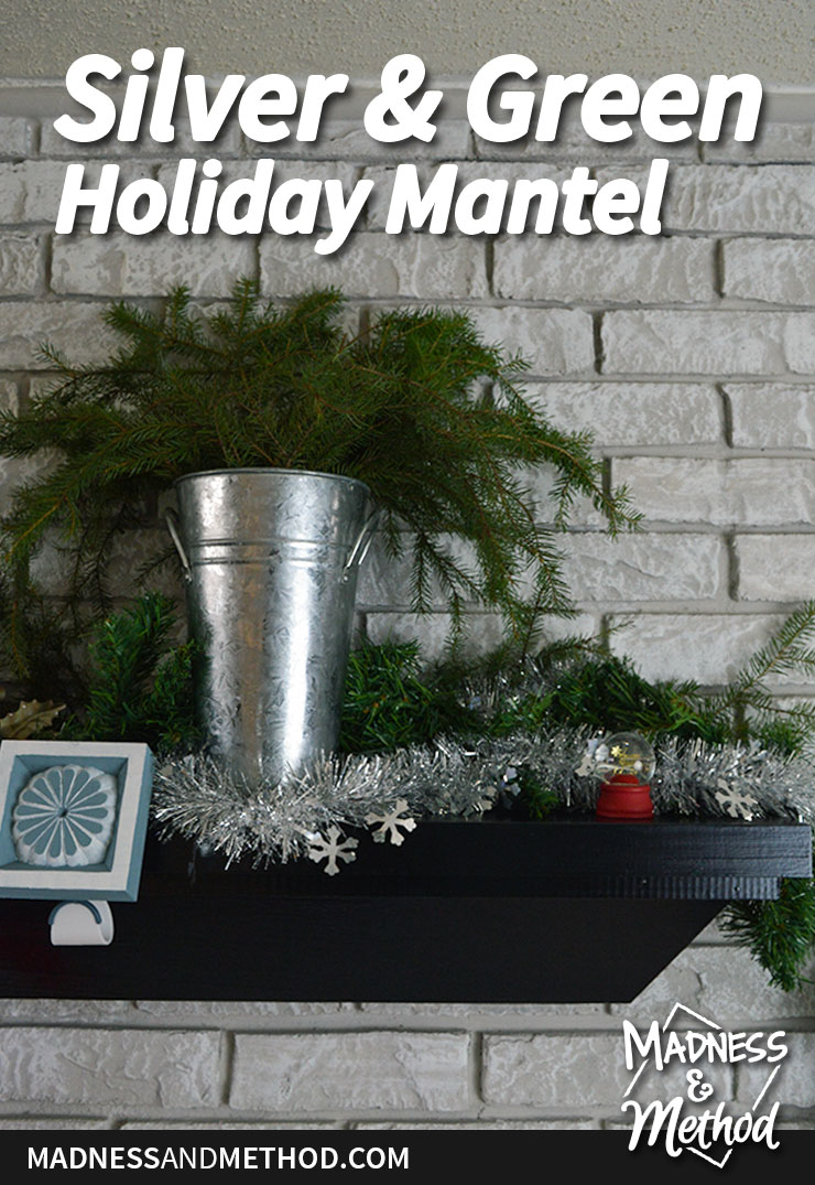 simple silver and green holiday mantel