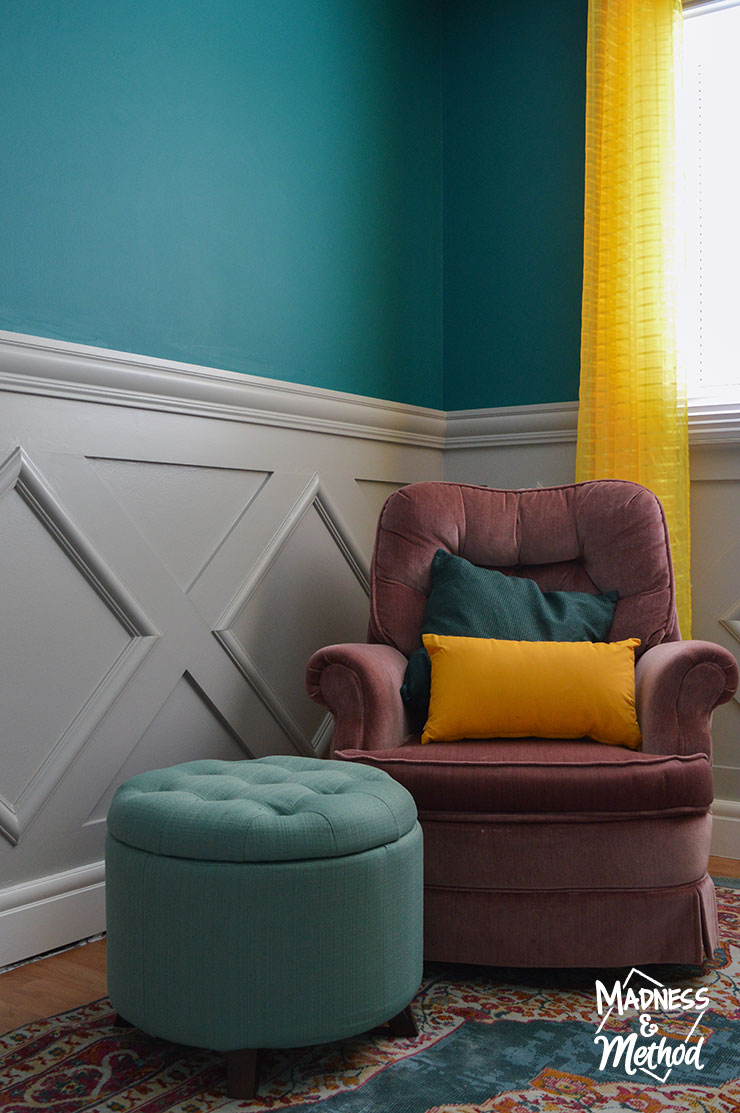 gray wainscoting with pink chair