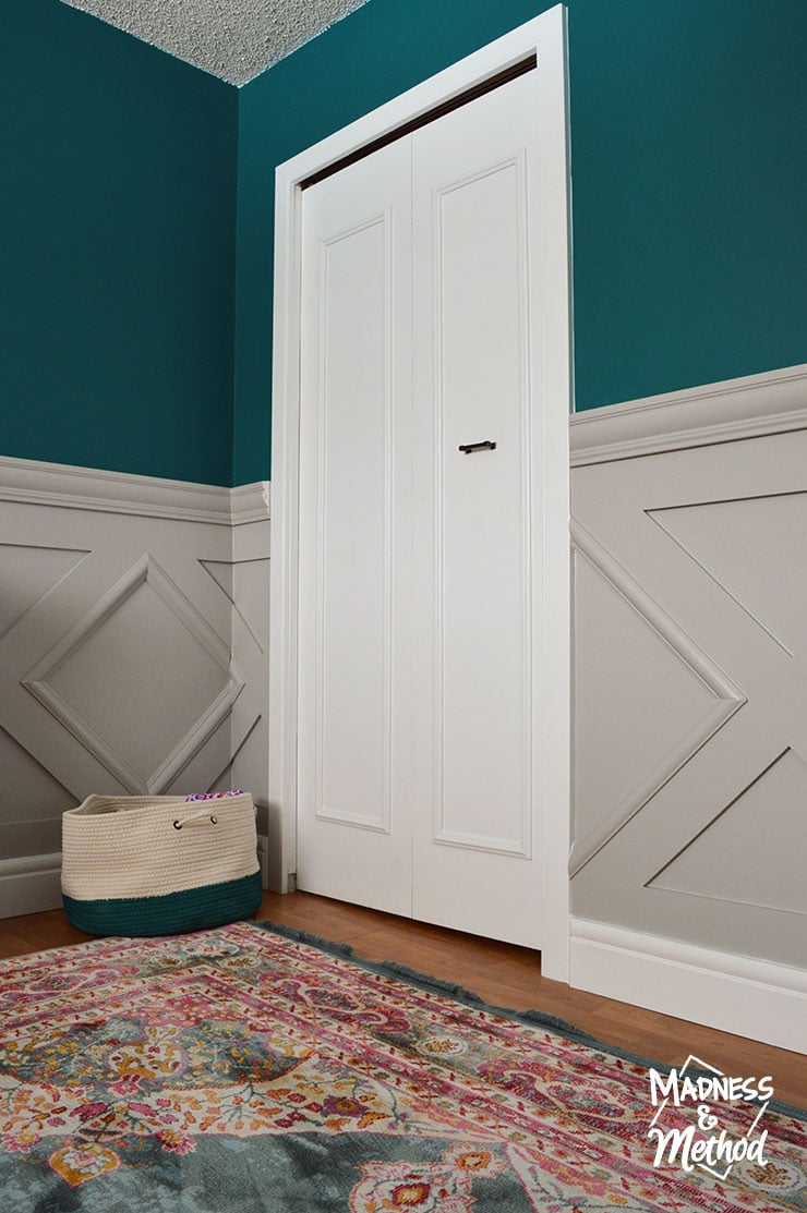 update closet doors in dark teal nursery