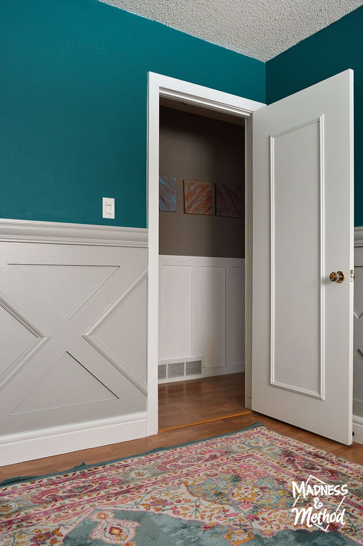 white doors with dark teal walls
