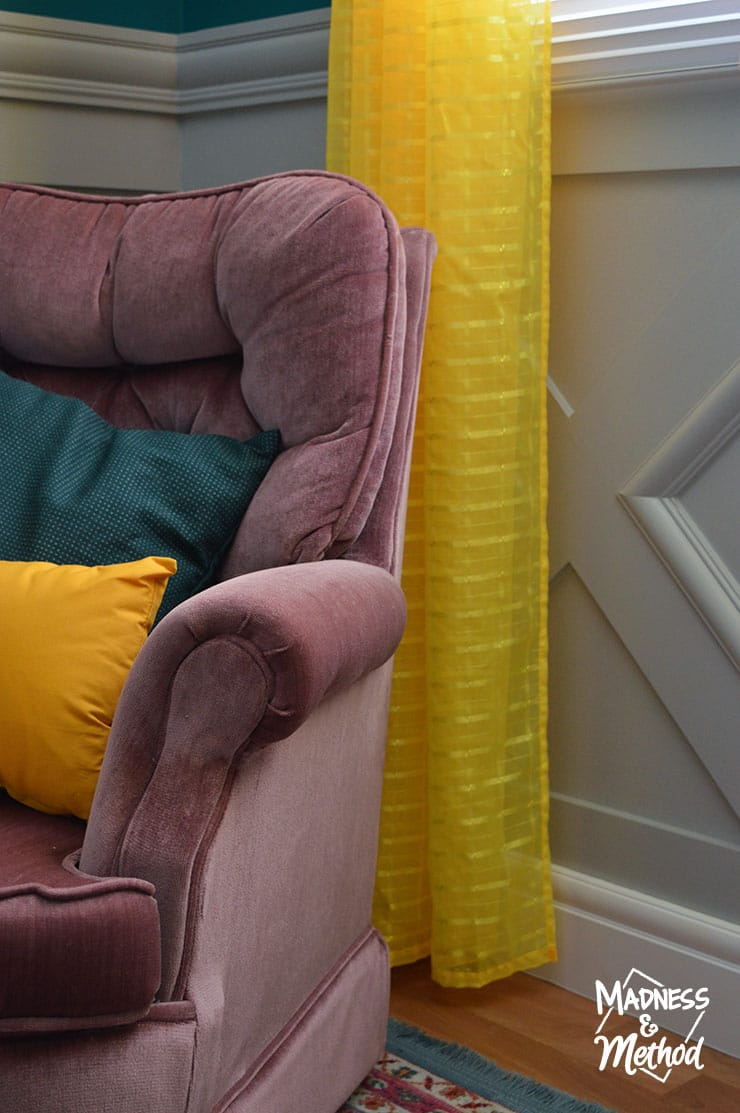 pink chair with yellow curtains