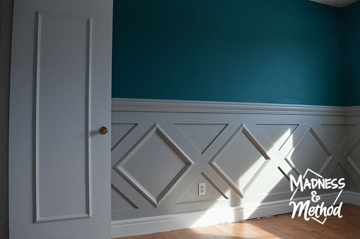 gray diamond wainscoting with white baseboards