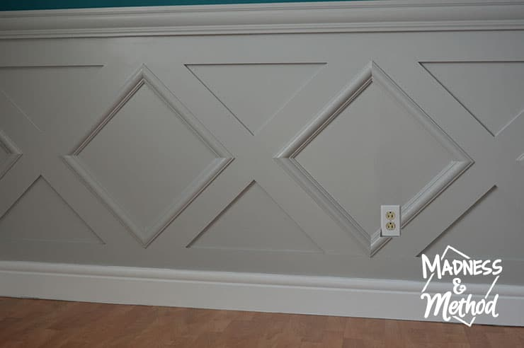 gray wainscoting with white baseboards