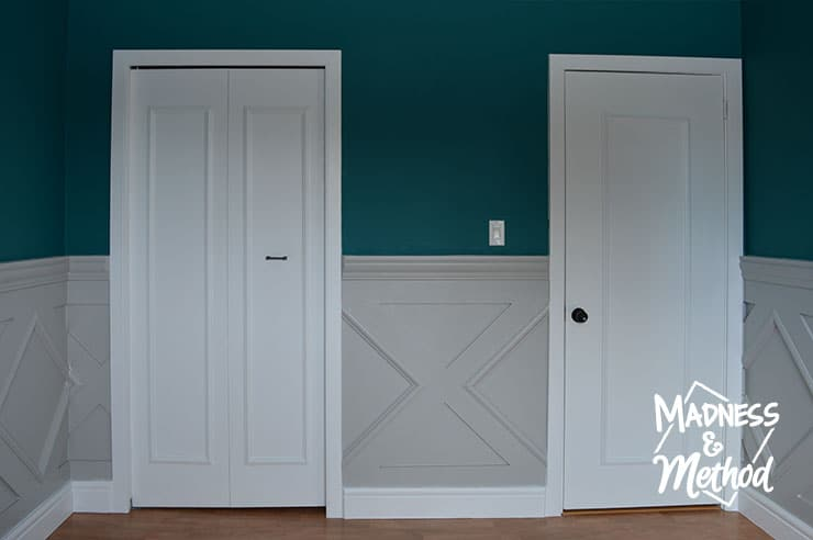 panelled doors with gray wainscoting