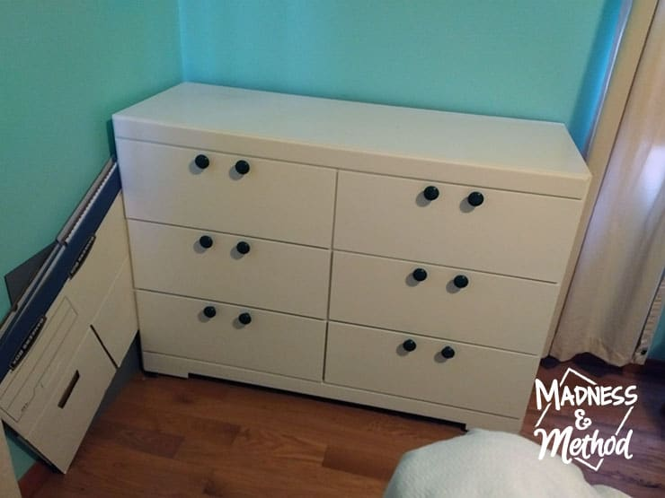 white 6 drawer dresser with green knobs