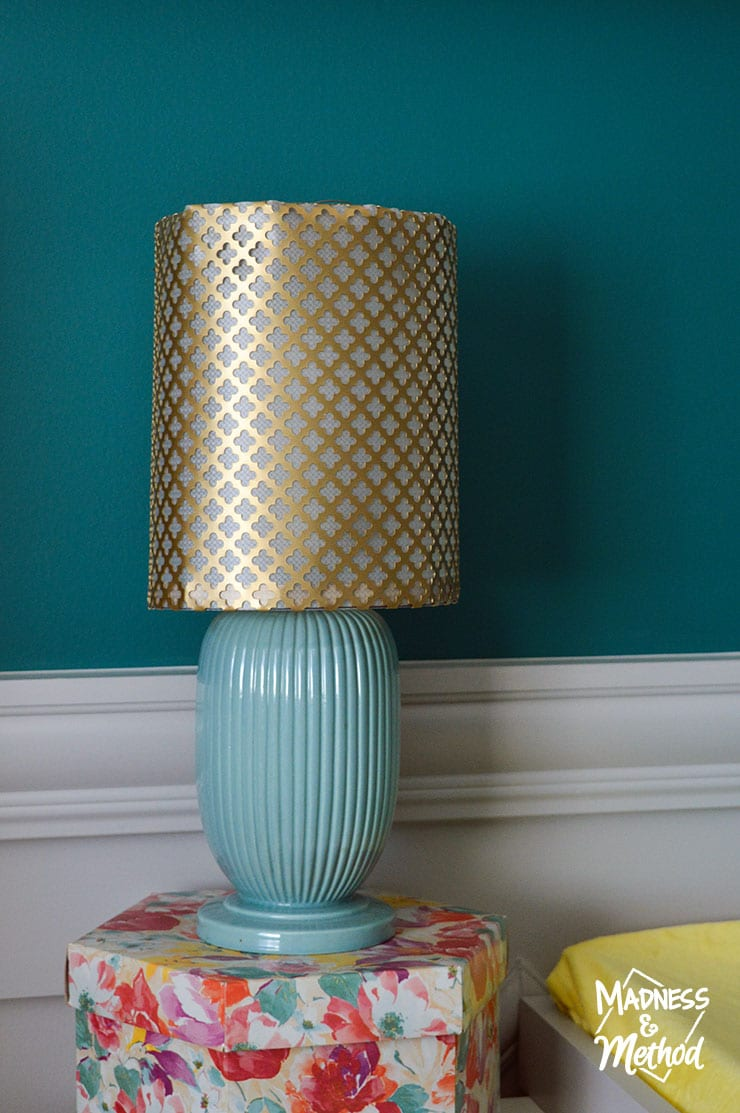 brass metal lampshade on turquoise base