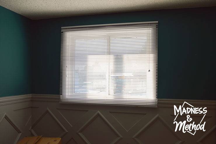 white horizontal blinds in nursery