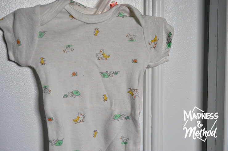 baby t-shirt hung on closet
