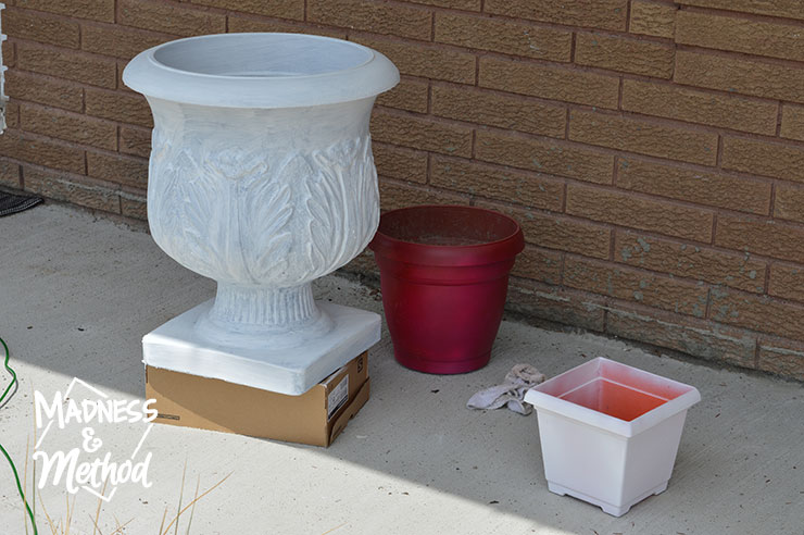white and red painted planters